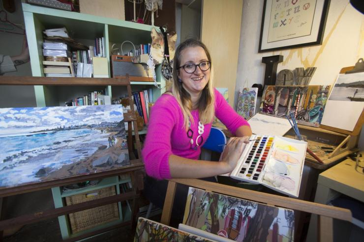Katie preparing for 'Paintings from my Suitcase' Art Show. Credit: Peter Beal
