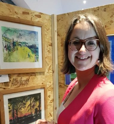 Me at a Hampshire Exhibition Private View with my paintings.